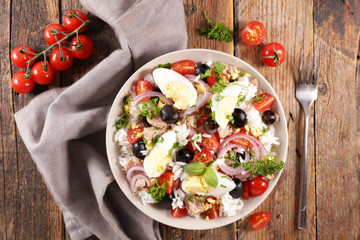Wall Mural - rice mixed salad with vegetable, tuna and egg