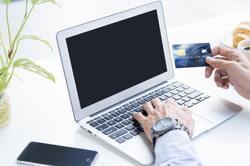 Man holding a credit card for online shopping