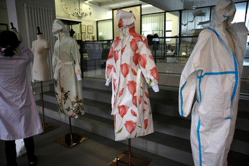 Protective suits with printed patterns designed by Zhou Li are seen displayed at a studio in Beijing