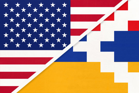 USA and Artsakh national flag from textile. Relationship between two american and asian countries.