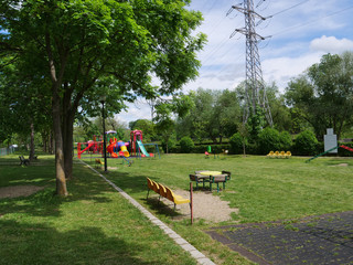 Empty children's playground and benches during covid-19 pandemic lockdown