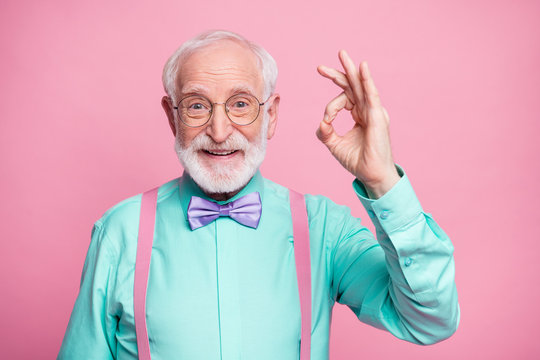 Portrait of positive cheerful old gentleman show okay sign decide choose perfect ads decisions choice wear good look outfit purple bow tie isolated over pastel color background