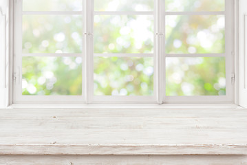 Vintage wooden table on blurred window background for product display