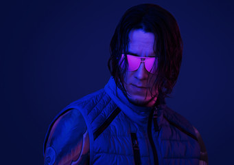 Retro wave portrait of young man in pink sunglasses.