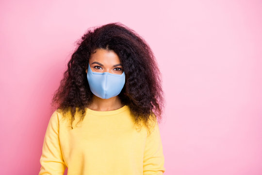 Closeup photo of pretty attractive trend modern hipster person wear pastel color jumper facial quarantine safety cotton mask having good mood isolated background