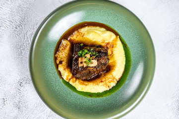 Beef sirloin fillet steak with a side dish of mashed potatoes. Gray background. Top view. Copy space