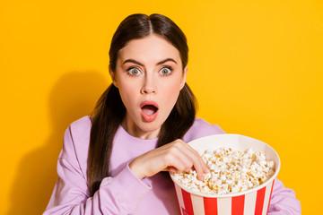 Portrait of astonished teenager girl watch tv impressed by unbelievable series endings scream wow...