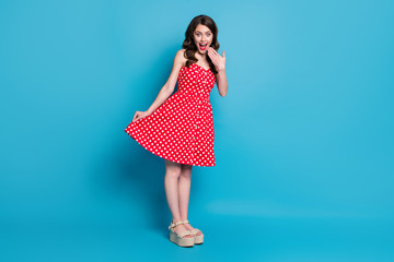 Full size photo of pretty lady mischief mood flirty raise skirt hand near mouth tricky wear summer...