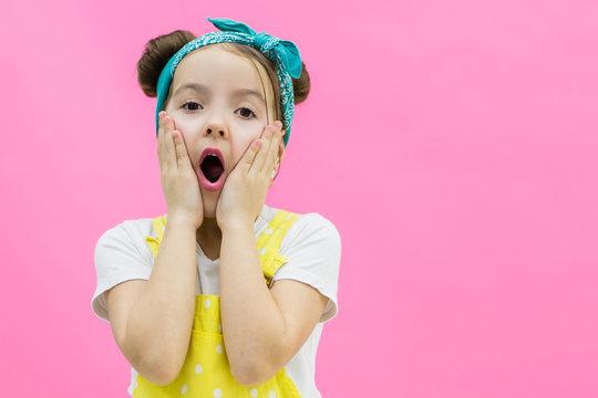 Little girl looks suprised. Little girl looks suprised