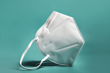 White FFP2, KN95 respirator. Dust protection respirator or medical respiratory mask against the...