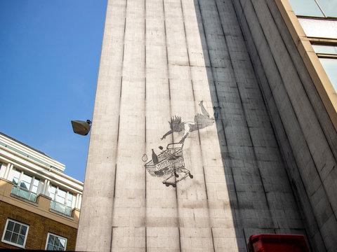 Banksy graffiti in Mayfair known as falling shopper.