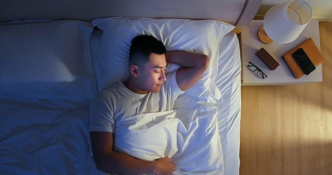 asian man sleep well