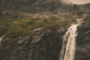 Wall Mural - Waterfall And Rocks Landscape Of Norway.