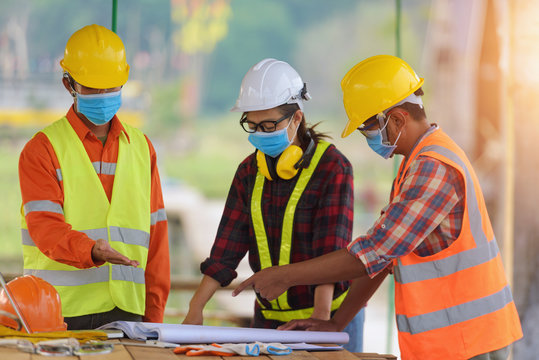 Corona or Covid-19 wear masks during the design of construction. New normal.Industrial engineering team wears a COVID 19 protective mask. Workers wear a quarantine face mask.