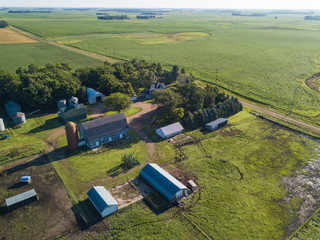 Aerial view of farmhouse and barns in South Dakota, USA.