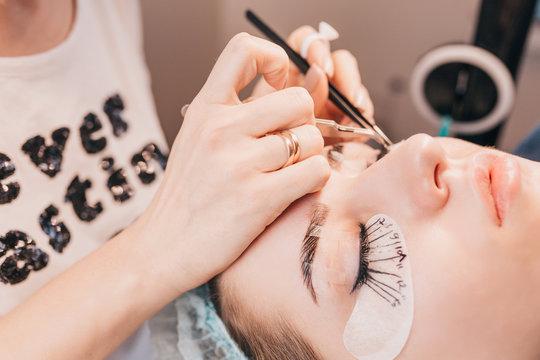 Beauty Salon - Sticking Artificial Eyelashes on the Eyelids in Bundles - Eyelash Extensions