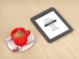 E-book reader and coffee on a wooden table