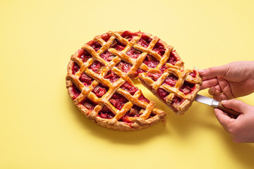 Rhubarb and strawberry pie sliced. Serving slice of pie