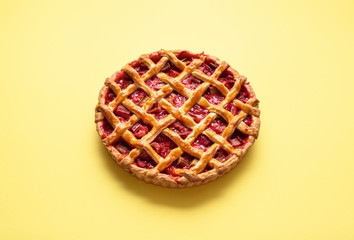 Strawberry and rhubarb pie with a lattice crust. Fruits dessert