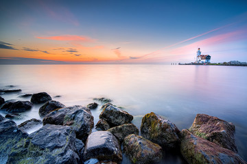 Canvas Prints Horses Lighthouse on the Dutch coast near the island of 'marken' during sunrise on a large inland lake
