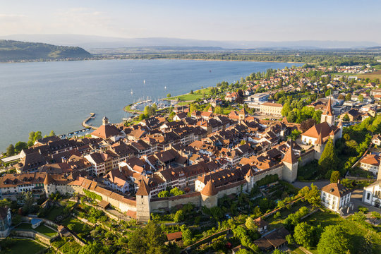 Aerial view of the famous medieval Morat, or Murten in German, old town by lake Morat in canton Fribourg in Switzerland