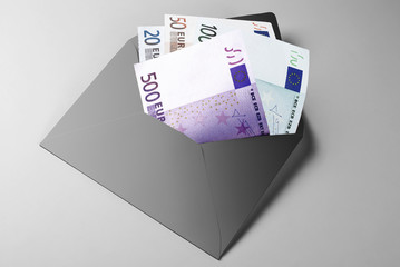 Financial aid: 20, 50, 100, and 500 Euro Bills in grey envelope