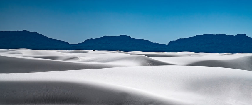 A serene view of White Sands National Park in New Mexico at the end of the day.