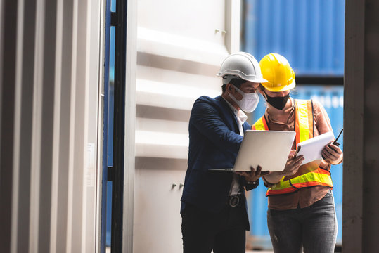 Businessmen, executives and engineers wear medical face masks. While inspecting industrial plants and warehouses for international shipping businesses Concepts of import and export