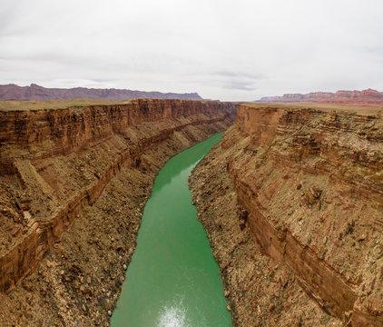 Aerial of The Colorado River Cutting a Green Line through the De