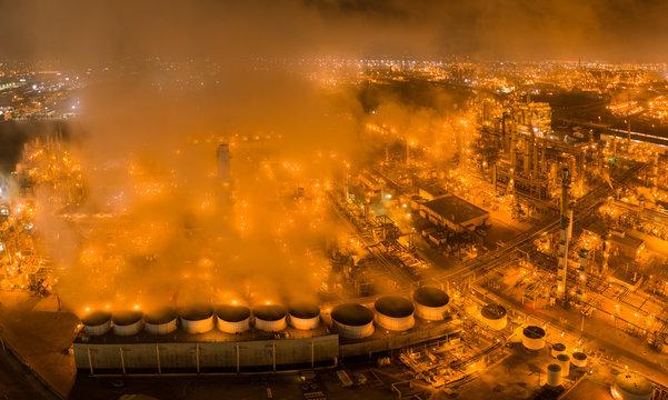 Refinery and Steam Glowing Orange in Night Aerials