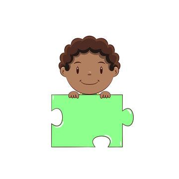 Boy holding puzzle piece, happy cute child