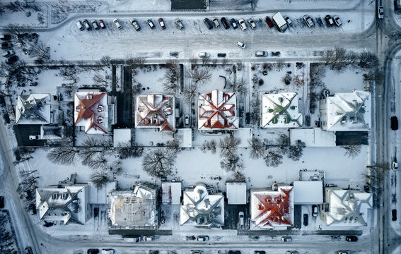 Snow covered residential houses in city district