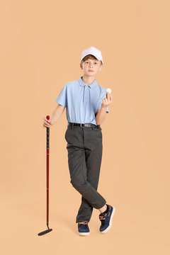 Cute little golf player on color background