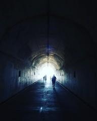 Keuken foto achterwand Tunnel Rear View Of Silhouette Man Walking In Tunnel