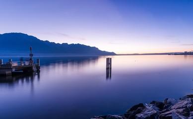 Spoed Fotobehang Pier Scenic View Of Lake Against Sky During Sunset