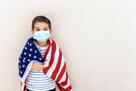 Little child with american flag and face mask