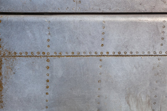 Old aircraft aluminum texture with rivets.