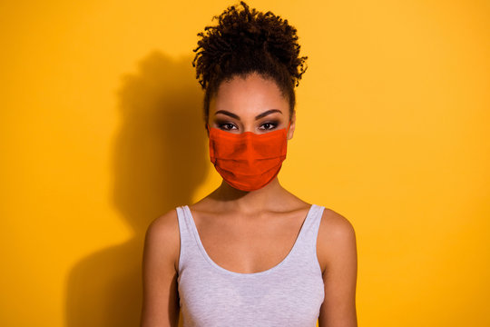 Close up photo beautiful amazing funny she her dark skin lady protect from covid-19 infection stay home look wear breathing mask casual tank-top isolated vivid yellow background