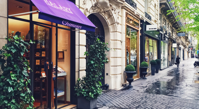 Paris, France circa January, 2020: Parisian architecture and historical buildings, restaurants and boutique stores on streets of Paris, France