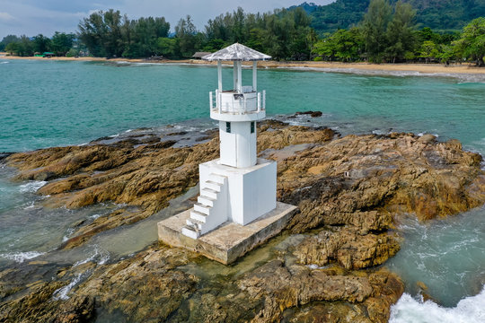 Aerial drone view of a small lighthouse off a tropical beach (Khao Lak, Thailand)