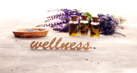 lavender herbal oil and lavender flowers. bottle of lavender massage oil for aromatherapy treatment...