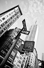 Low Angle View Of One Way Sign Against Empire State Building