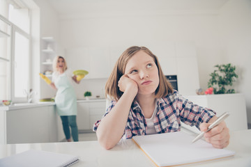 Photo of little blonde hair girl frustrated sit table cant do homework mother tutor housewife wash...