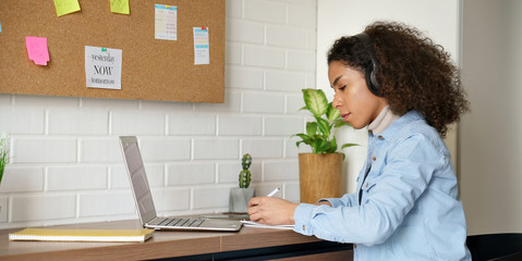 African teen girl school college student remote worker wear headphones learn watch online webinar...