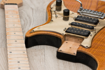 Electric guitar repair. Neck removed from body for refinishing Wall mural