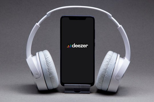 Belgorod , Russia - MAY, 16, 2020: Mobile phone with Deezer logo on screen, Stream Songs and Videos app