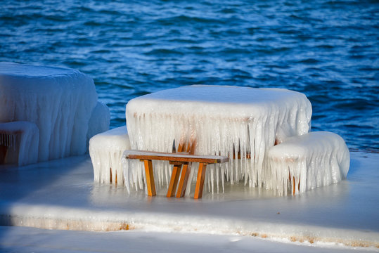 Picnic table encased in ice after a storm