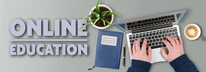 e-learning and online education concept, top view of person using laptop computer on desk with text ONLINE EDUCATION