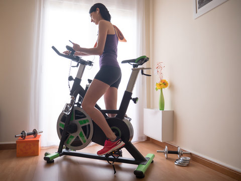 Young girl doing exercise at home.