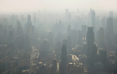 Wall Murals New York City City air pollution. Aerial view of Shanghai from Jinmao tower in China